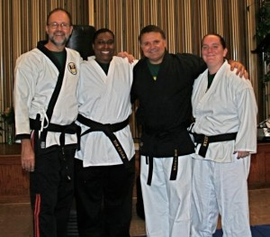 Senior Instructor Mark McGee and Grace Martial Arts Black Belt Instructors